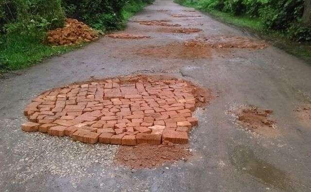 Ямковий ремонт доріг своїми силами (14 фото)
